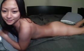 Tan Asian girl enjoys bedroom fuck with BF